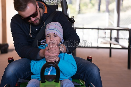 father and son enjoys driving on