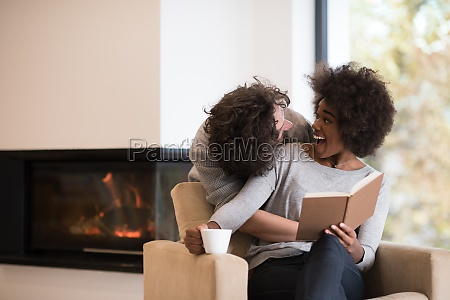 multiethnic couple hugging in front of