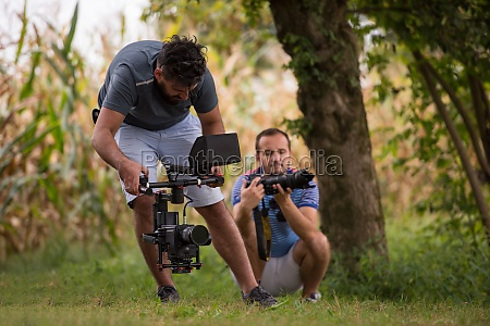 young videographer recording while woman doing