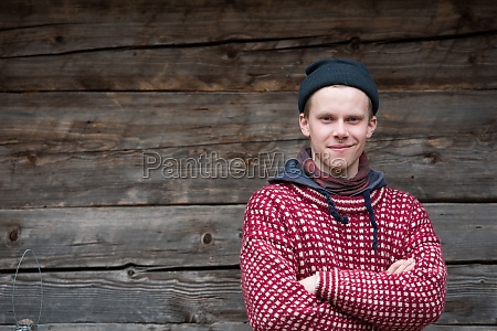 young hipster in front of wooden