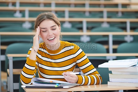 student taking notes for school class