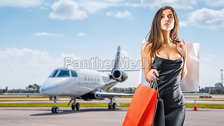young beauty with shopping bags in