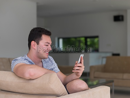 young man using a mobile phone