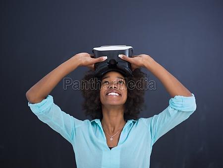 black girl using vr headset isolated