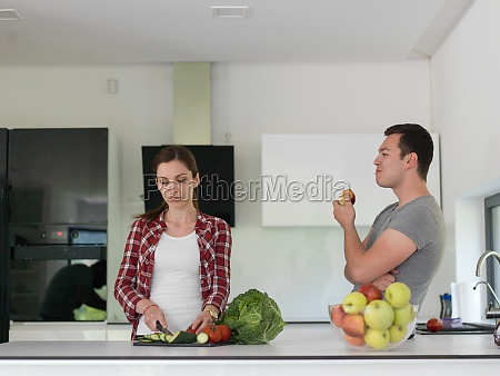 young handsome couple in the kitchen