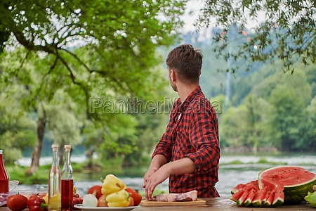 man cooking tasty food for french