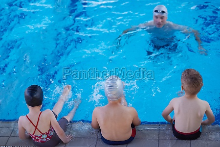child group at swimming pool