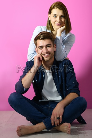couple sitting on the floor while