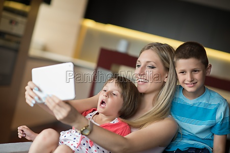 young family using a tablet to