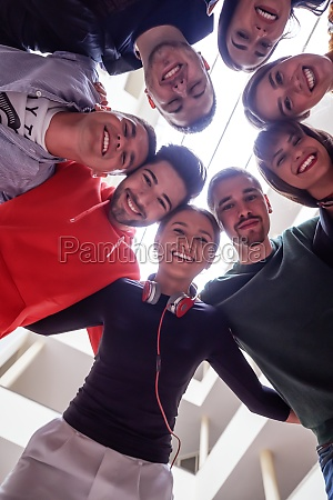 group of happy young people showing