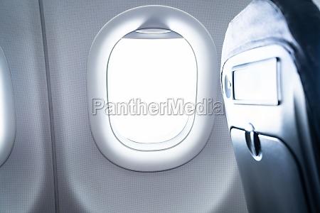 airplane window seat economy class travel