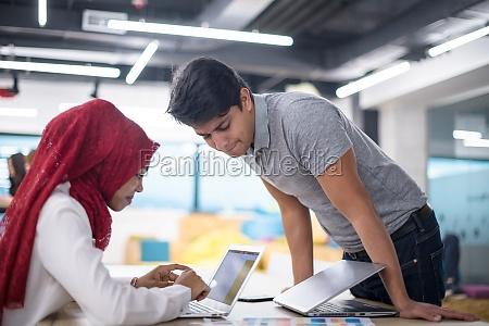 black muslim business woman having a