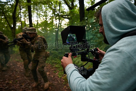 videographer taking action shoot of soldiers