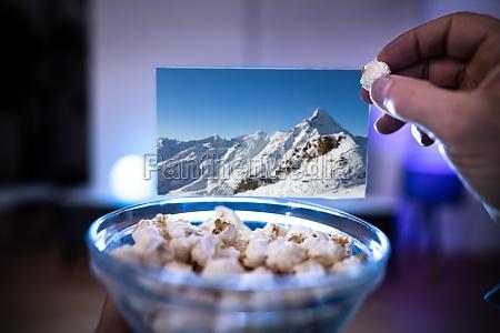 enjoying popcorn snacks watching tv or