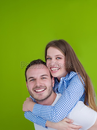 man piggybacking his girlfriend