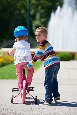 boy and girl in park learning