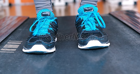 black female feet in sneakers
