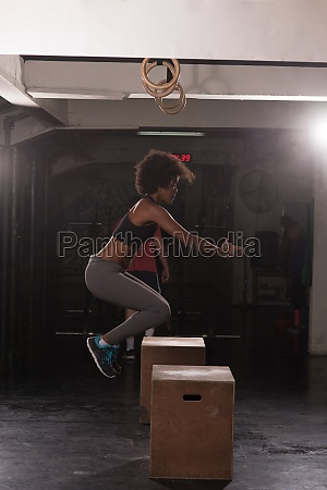 black female athlete is performing box