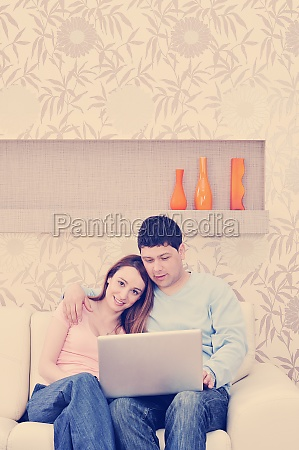young couple working on laptop at