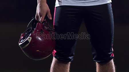 portrait of young confident american football