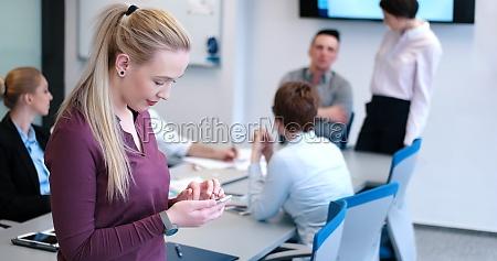 elegant woman using mobile phone in