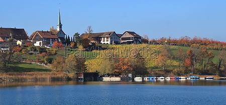 idyllic village seegraben in autumn fishing