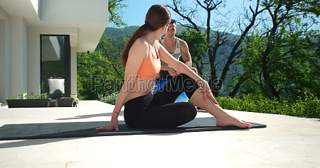 couple doing stretching exercises together in