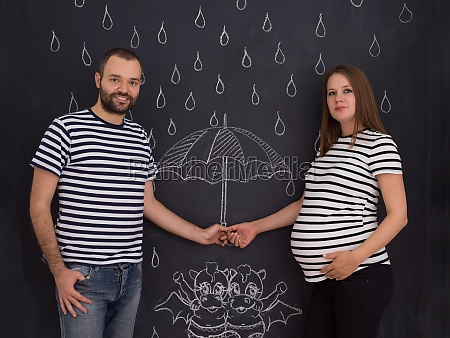 pregnant couple drawing their imaginations on