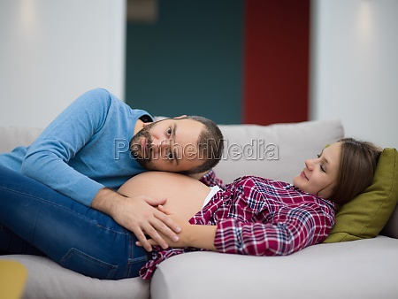 future dad listening the belly of