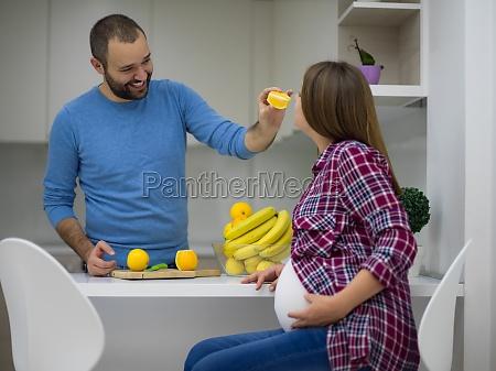 couple cooking food fruit lemon juice