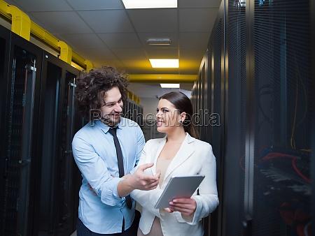 engineer showing working data center server