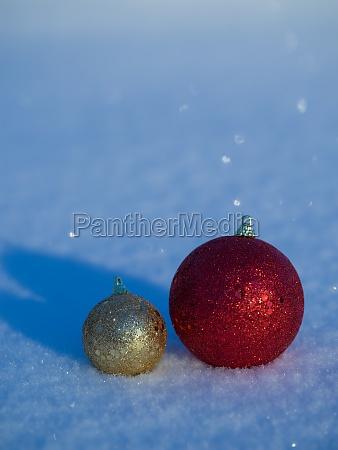 christmas balls decoration in snow