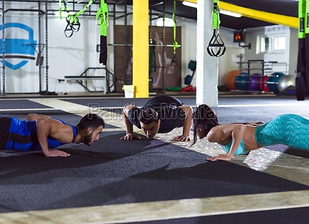 young healthy people doing pushups