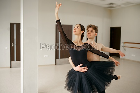 female and male ballet dancers in