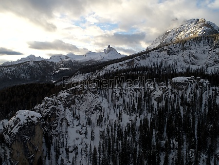flying above mountain trees on winter