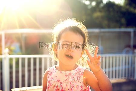 toddler at sunset