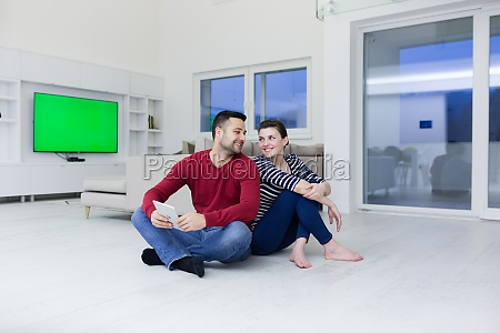 young couple using digital tablet on