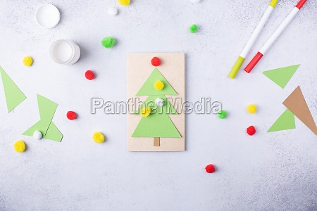 the child makes a greeting card