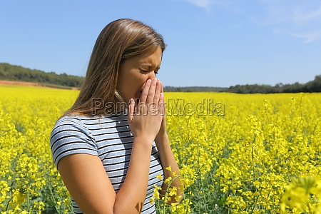 allergic woman coughing in a yellow