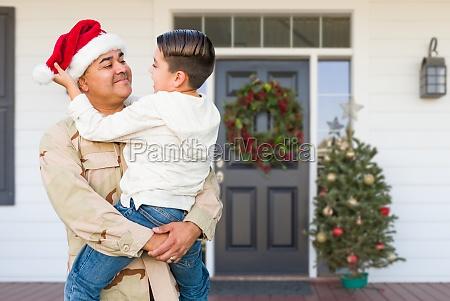 hispanic male soldier wearing santa cap