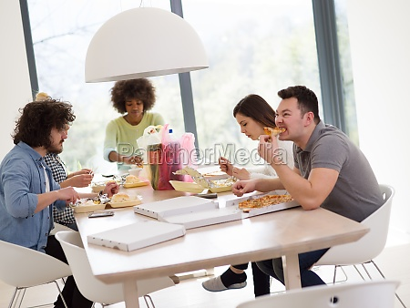 multiethnic group of happy friends lunch