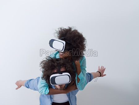 multiethnic couple getting experience using vr