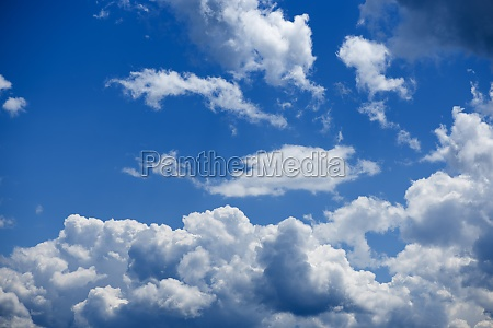cloudy sky with blue sky over