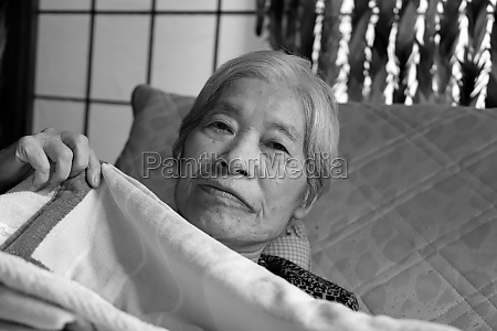 elderly woman reclining on the nursing