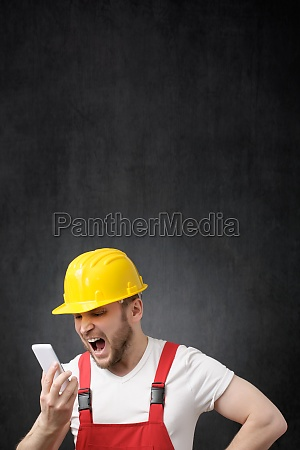 a construction worker shouting on the