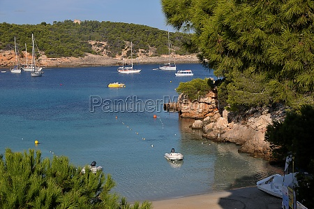 bay of portinantx with sailing yacht