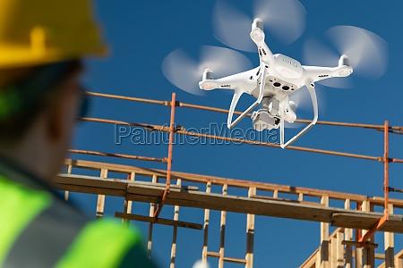 female pilot flies drone quadcopter inspecting
