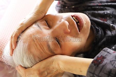 a senior woman lying on a