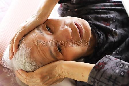 senior lady lying on the nursing