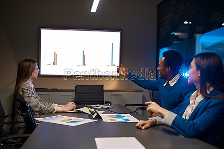 managers on business presentation in night